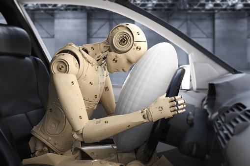Crash test dummy in car